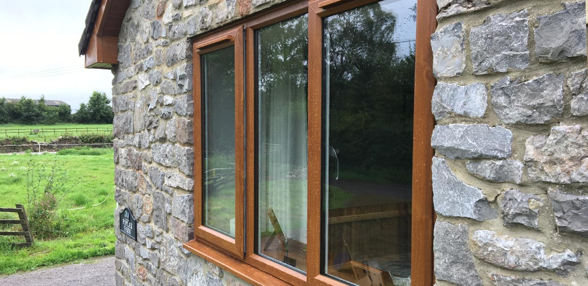 Double glazed upvc window in timber effect style with oak finish
