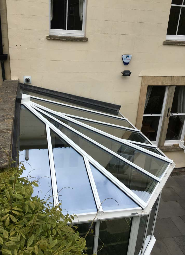 White aluminium lean-to conservatory with glass roof