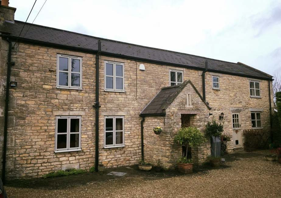 Domestic installation with new aluminium windows suited to traditional property