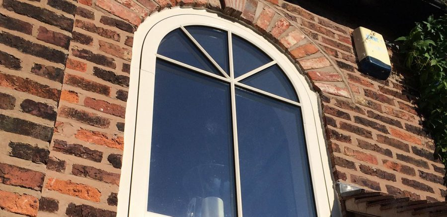 Arched upvc window in cream finish