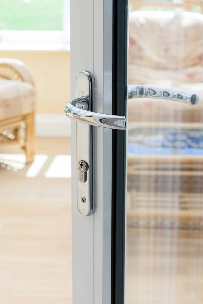 Bifolding door with polished chrome hardware supplied for homeowner