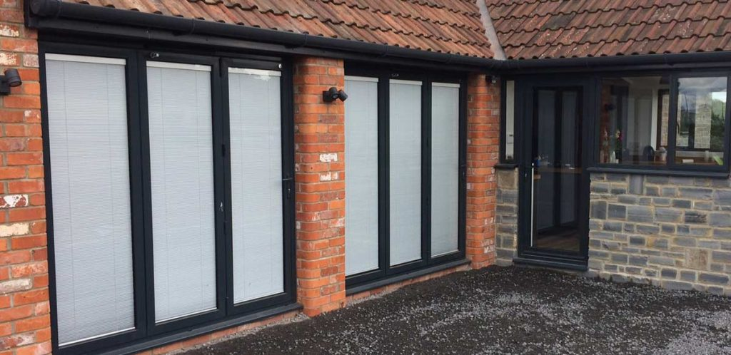 Bifold doors with integrated blind system