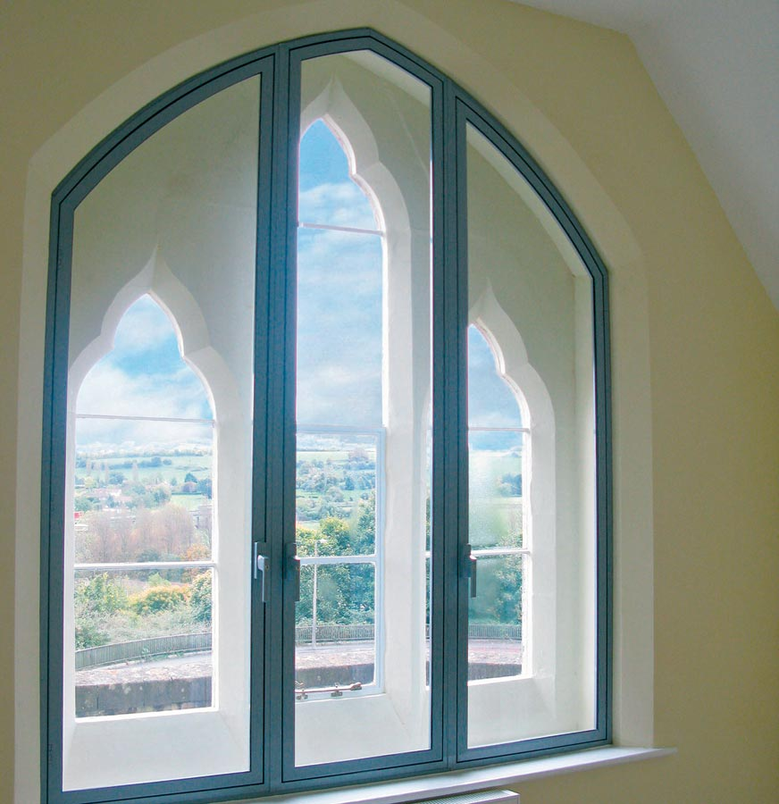 Grey coloured secondary glazing unit made with aluminium