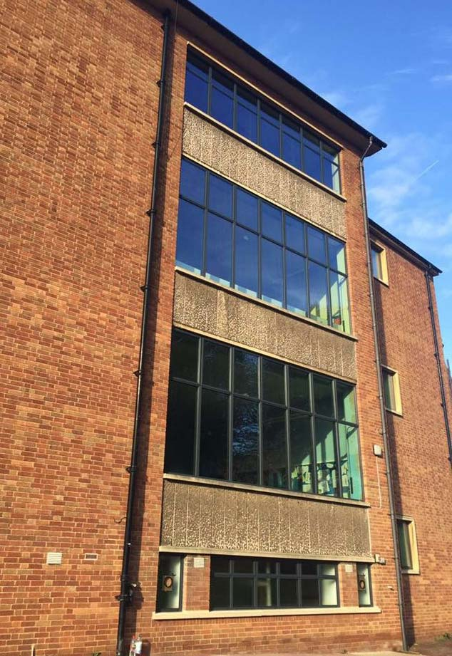 Aluminium curtain wall installation for older commercial building
