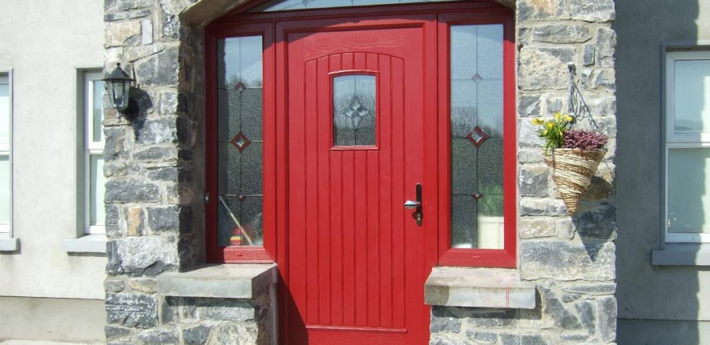 Red composite entrance door with decorative glazing supplied and fitted
