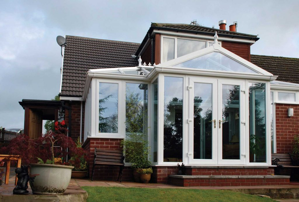 A uPVC conservatory in p-shape design with glass roof