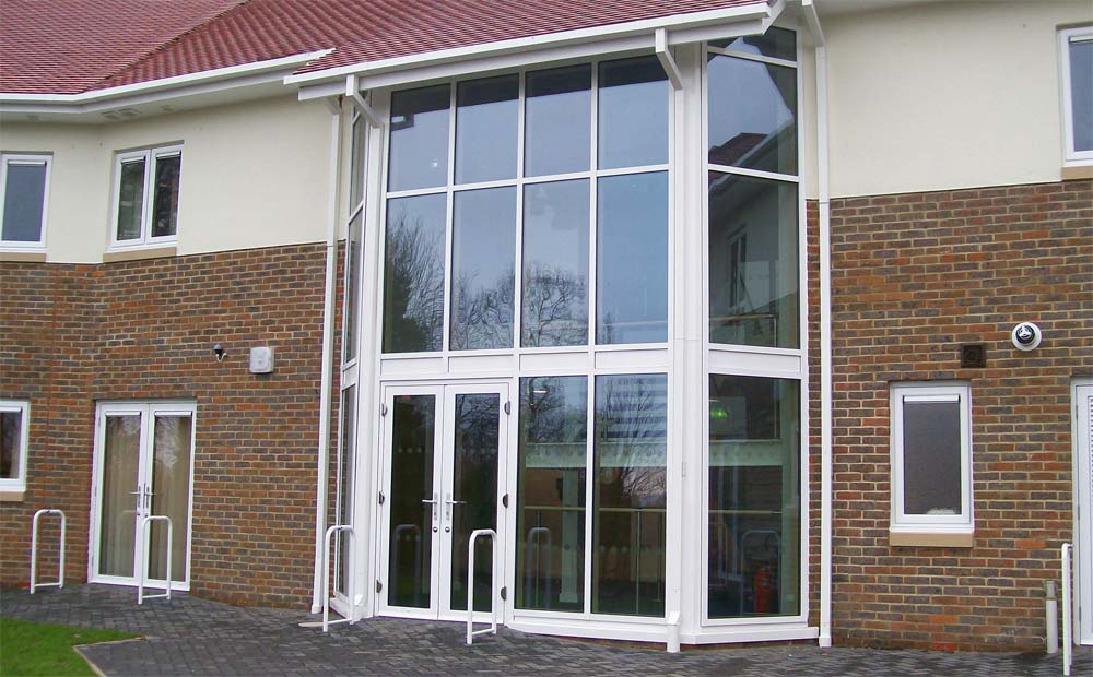 Entrance facade for commercial building made using smart aluminium curtain wall system