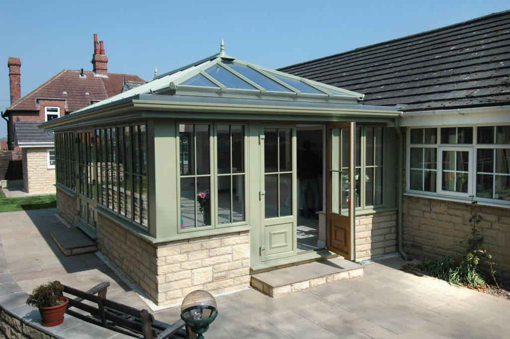 Glazed orangery constructed using a brick base and uPVC frames