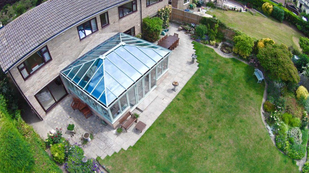 large green uPVC conservatory for large residential project