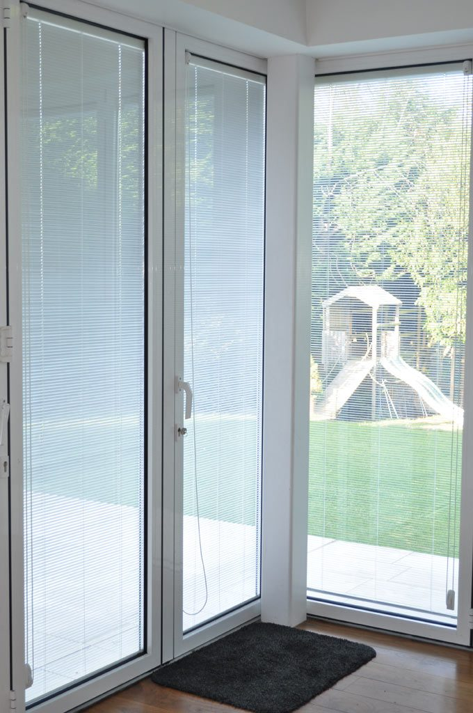 Integral blinds in white fitted into glazing panel