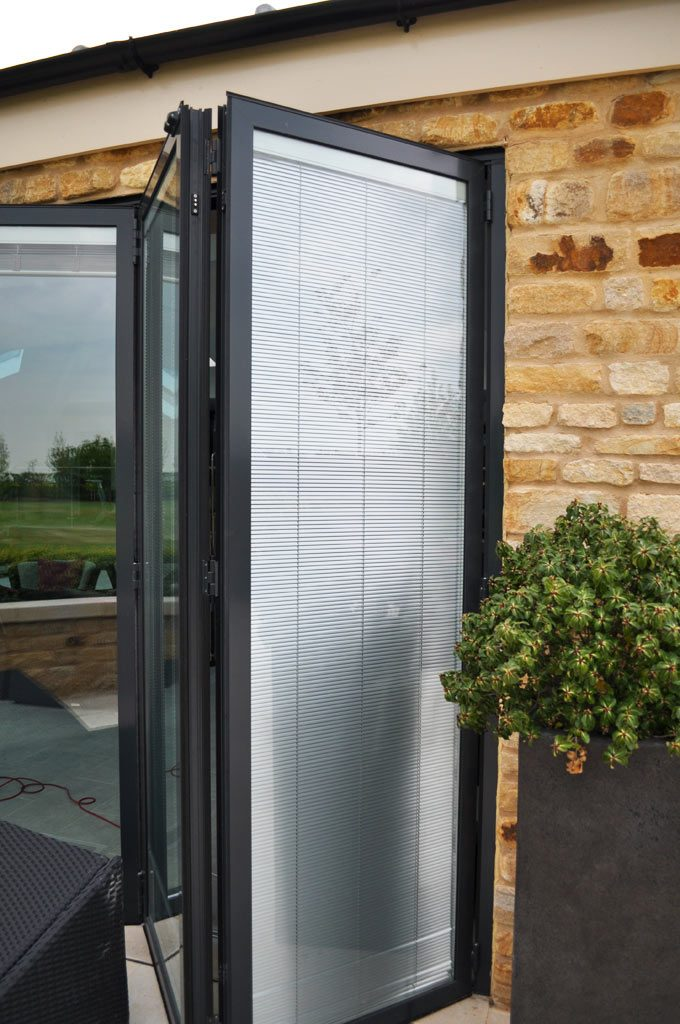Integrated blinds for bifold doors