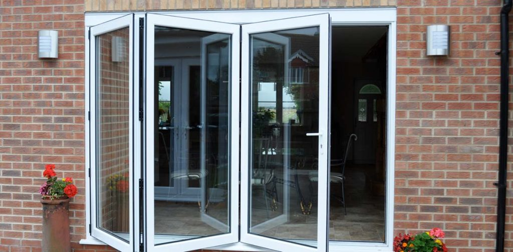 white bifold doors slightly open to show folding functionality