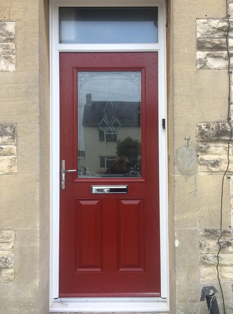 Red composite entrance door with chrome hardware