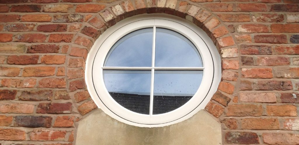 Round upvc timber look window with double glazing
