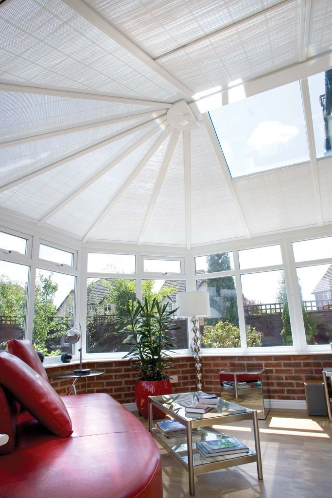 uPVC conservatory with roof windows and blinds