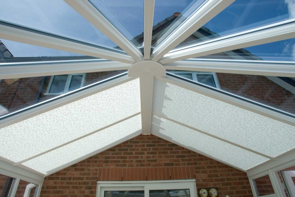 Roof system for conservatory with custom made blinds