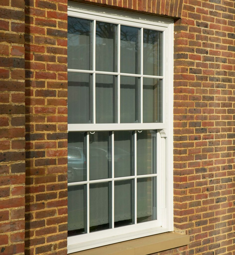 uPVC vertical sliding sash window with georgian bars