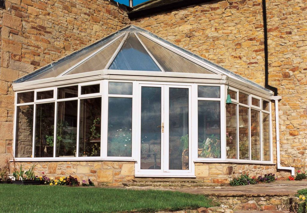 Wok/ Victorian corner fill shaped conservatory with uPVC frame and polycarbonate roof