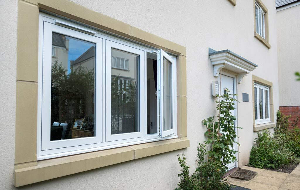 White flush sash timber effect window