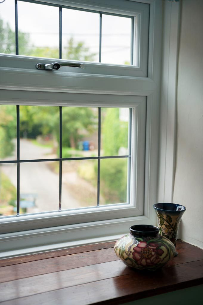 Internal view of a timber effect upvc window with traditional style handle